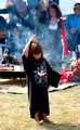 0110:  Little Girl Dancing for Peace in Front of Sacred Fire and Elders